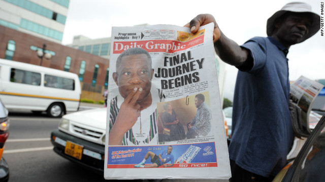 A newspaper vendor in Accra holds a copy a daily Wednesday featuring Mills on the front page. The president's death came several days after he celebrated his 68th birthday. He had said he would run for re-election in December.
