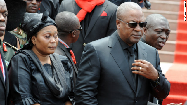 John Dramani Mahama, who was sworn in as Ghana's president after the death of Mills, and his wife arrive Wednesday to parliament to pay their respects.