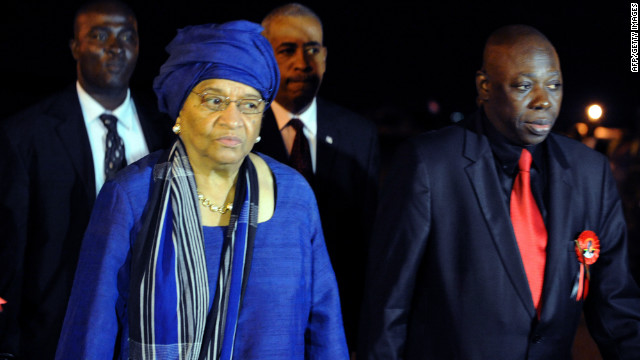 Liberian president Ellen Johnson Sirleaf is escorted by Ghanaian foreign minister Muhammad Mumunis upon her arrival Thursday in Accra to attend the funeral. 