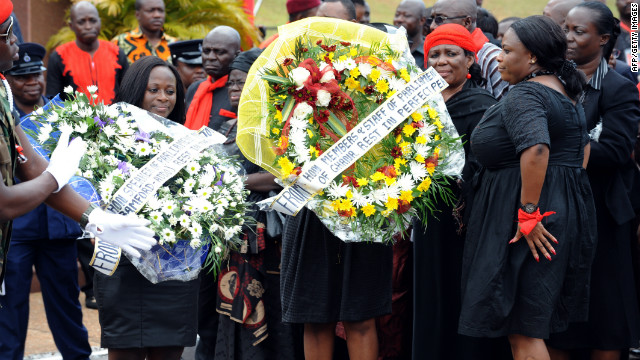 Members and staff of Ghana's parliament arrive to pay their last respects to Mills on Wednesday.