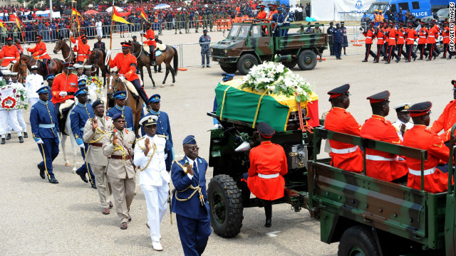The coffin of Mills is escorted Friday to the Independence Park in Accra for the funeral service. A military cortege conveyed Mills' body from the State House parliamentary complex, where it had lain in state since Wednesday, to Independence Square, where more than 10,000 people had gathered.