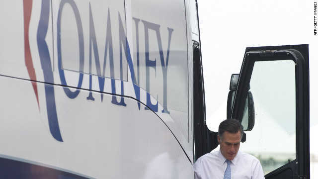 Romney exits his bus at the campaign event.
