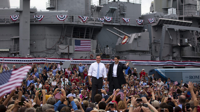 Romney, left, and Ryan wave at supporters in front of the USS Wisconsin.