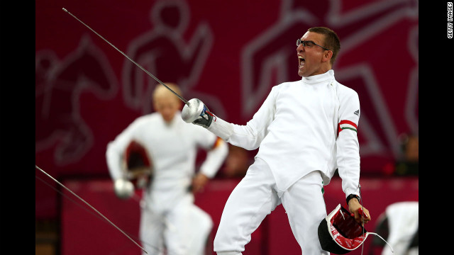 Hungary's Adam Marosi celebrates winning a fencing bout during the men's modern pentathlon.