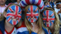 Team GB supporters with their faces painted in Union Jack designs at the Olympic Stadium in London.