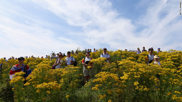 Spectators watch the women's cross-country mountain bike race.