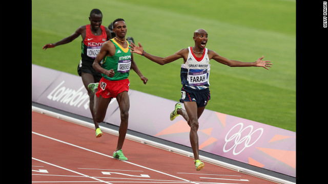 Mohamed Farah, of Great Britain, celebrates as he crosses the finish line to win gold ahead of Ethiopia's Dejen Gebremeskel and Kenya's Thomas Pkemei Longosiwa in the men's 5000-meter final.