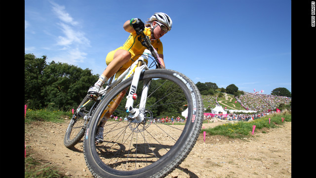 Rebecca Henderson of Australia competes in the women's cross-country mountain bike race.