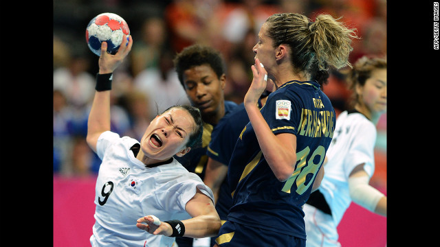 South Korea's pivot Cha Youn Kim, left, shoots during the women's bronze medal handball match between South Korea and Spain.