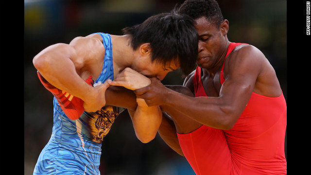 Japan's Kenichi Yumoto, left, can't believe how smooth Cuba's Yowlys Bonne Rodriguez's legs are.