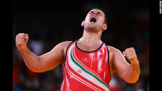 Komeil Ghasemi of Iran celebrates winning the bronze medal in the men's 120-kilogram freestyle wrestling.