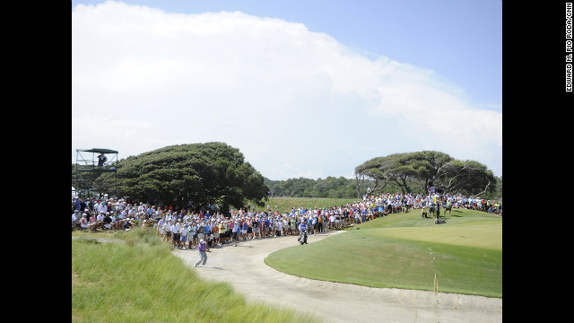 Fans watch the pairing of Graeme McDowell and Phil Mickelson on Saturday.