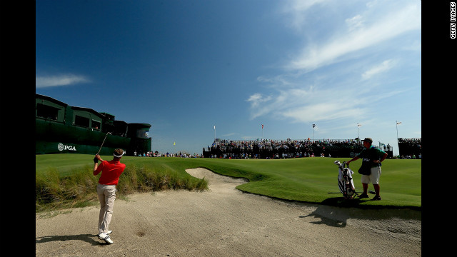 David Lynn of England hits out of the sand on the 18th hole.