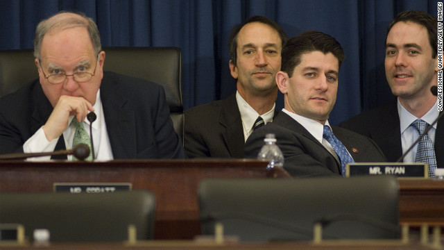 Then-Budget Committee Chairman John M. Spratt Jr., left, and ranking member Ryan listen to Federal Reserve Chairman Ben Bernanke testify during the House Budget hearing on the economy on January 17, 2008.