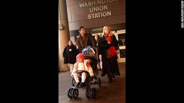 Ryan, with his wife Janna and daughter Elizabeth, 2, make their way to a train at Union Station in Washington on January 29, 2004.