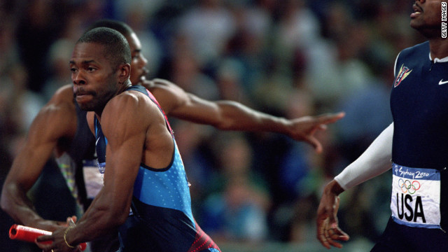 Antonio Pettigrew accepts the baton in the men's 4x400m en route to victory. He ran the second leg against Nigeria's Jude Monye among others. The runner would later admit to using EPO and human growth hormone during the Sydney Games. He committed suicide in 2010.