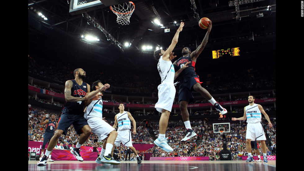 LeBron James, No. 6 of the United States, goes up for a shot against Luis Scola, No. 4 of Argentina, during the men's basketball semifinal match on August 10. The games ran through August 12 -- <a href='http://www.cnn.com/2012/08/09/worldsport/gallery/olympics-day-thirteen/index.html'>check out the best moments from Day 13 of competition</a> on Thursday.