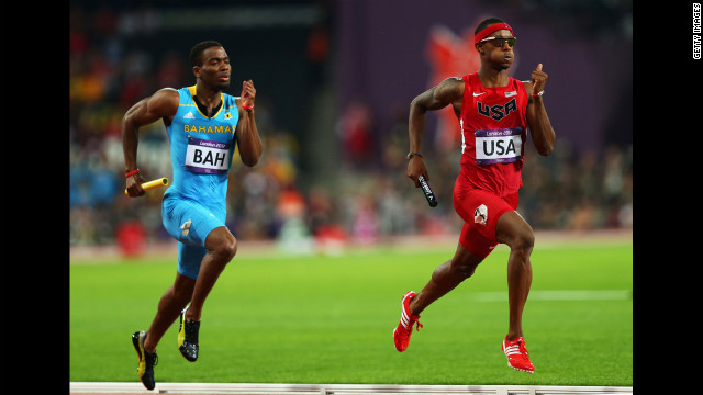 Michael Mathieu of the Bahamas and Tony McQuay of the United States compete in the Men's 4 x 400-meter relay final.