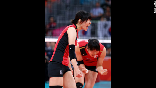 Risa Shinnabe, left, and Erika Araki of Japan celebrate after a point against Korea during the women's volleyball.