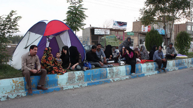 An Iranian family sits by a tent they erected along a street in Varzaqan, a town located 37.2 miles (60 kilometers) northeast of Tabriz, Iran.