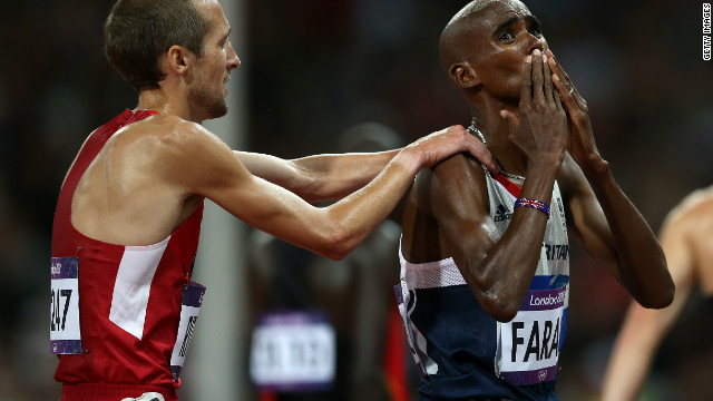 Team GB's Mo Farah celebrates winning the gold medal in men's 10,000m final with Dathan Ritzenhein of the United States.