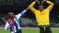 Mo Farah and Usain Bolt celebrate their success at the London 2012 Olympic Games by copying each other's