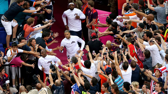 U.S. basketball players Kobe Bryant, Tyson Chandler and LeBron James head to the court before the start of the men's basketball gold medal game against Spain.