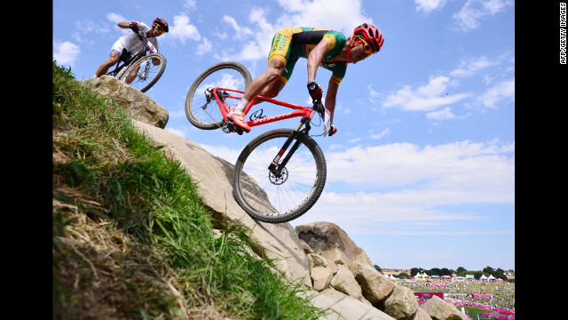 South Africa's Burry Stander, right, and Italy's Marco Aurelio Fontana navigate the course in the men's cross-country mountain bike race at Hadleigh Farm in Benfleet, England.