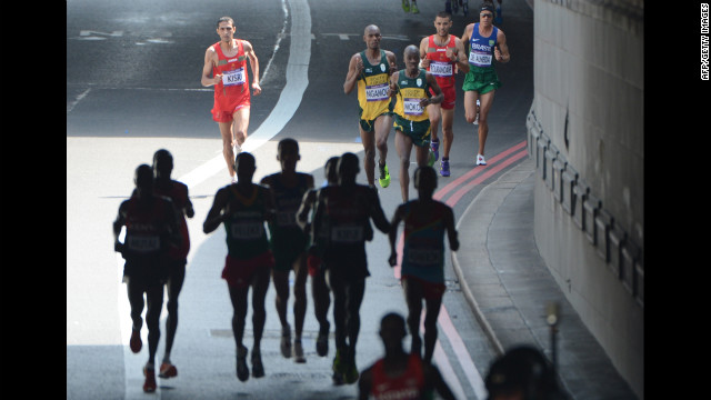 Runners pound the streets of London during the men's marathon. Stephen Kiprotich won the race to give Uganda its first gold medal of the Games.
