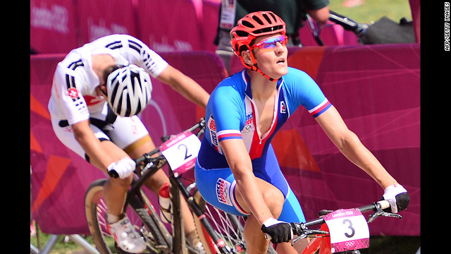 Czech cyclist Jaroslav Kulhavy crosses the finish line ahead of Switzerland's Nino Schurter to win men's cross-country mountain bike race at Hadleigh Farm.