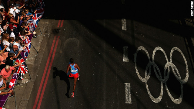 Yonas Kifle of Eritrea is cheered by spectators as he competes in the men's marathon on day 16 of the London 2012 Olympics, Sunday, August 12, the last day of the Games. See all the action as it unfolded here, and check out the best images from day 15 of competition on Saturday, August 11.