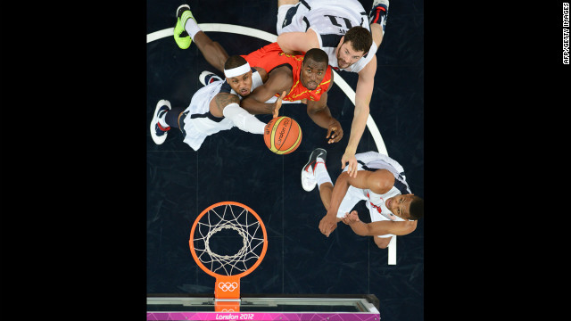 U.S. forward Carmelo Anthony, left, and Spanish center Serge Ibaka struggle for the ball during the men's gold medal basketball game between the United States and Spain.