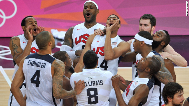 U.S. players celebrate after defeating Spain to win the gold medal in men's basketball.