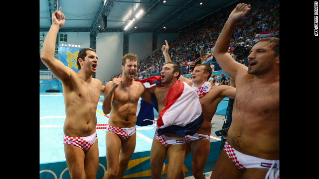 Croatia's Josip Pavic, center, celebrates with his teammates after Croatia defeated Italy in the men's water polo gold medal match.