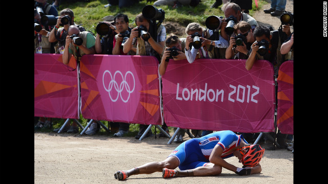 Czech Republic's Jaroslav Kulhavy is overcome by the moment after winning the men's cycling cross-country mountain bike race.