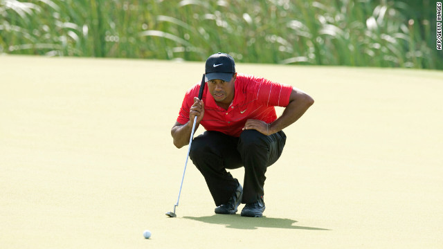 Tiger Woods lines up a putt during the third round.
