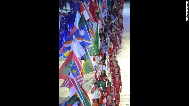 Flagbearers parade during the closing ceremony.