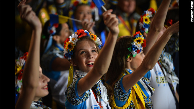 Girls perform at the Olympic stadium during the closing ceremony.