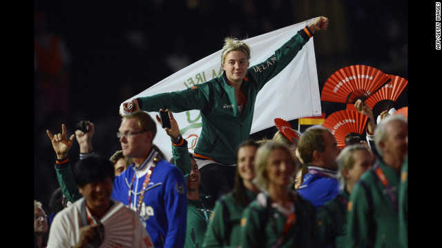 Athletes wave Irish flags at the Olympic stadium.
