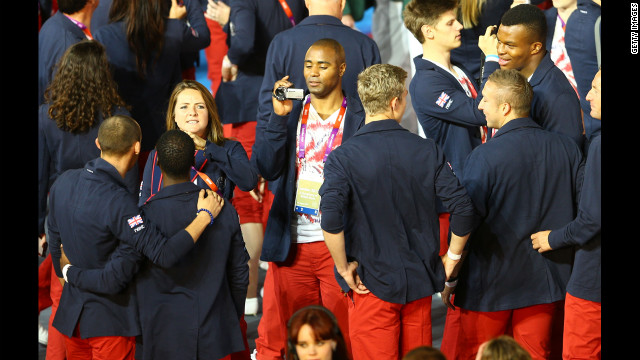 Athlete Mark Lewis-Francis of Great Britain films teammates.