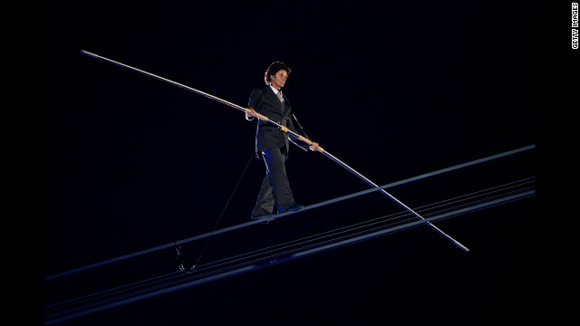 A high-wire artist performs during a rendition of Pink Floyd's &quot;Wish You Were Here.&quot;