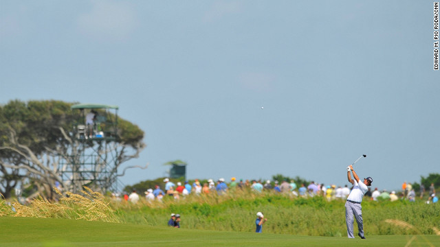 Phil Mickelson tries for the green from the fairway on the 7th hole.