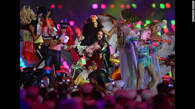 British comedian Russell Brand, center, performs at the Olympic stadium.