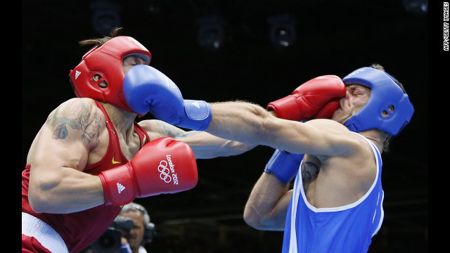Oleksandr Usyk of the Ukraine, in red, defends against Clemente Russo of Italy, in blue, during the heavyweight boxing final. Usyk won gold on a 14-11 points decision on Day 15 of the London 2012 Olympic Games on Saturday, August 11. Check out the best images from Day 14 of competition on Friday, August 10. The Games ran through Sunday, August 12.