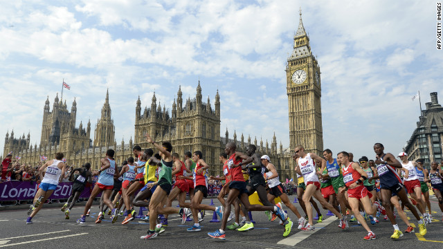 Athletes pass by Big Ben and the Palace of Westminster during the men's marathon.