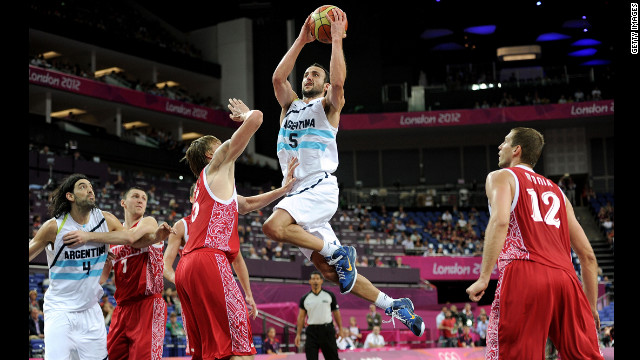 Manu Ginobili, center, of Argentina drives down the lane during the men's basketball bronze medal game against Russia. See photos from the closing ceremony.