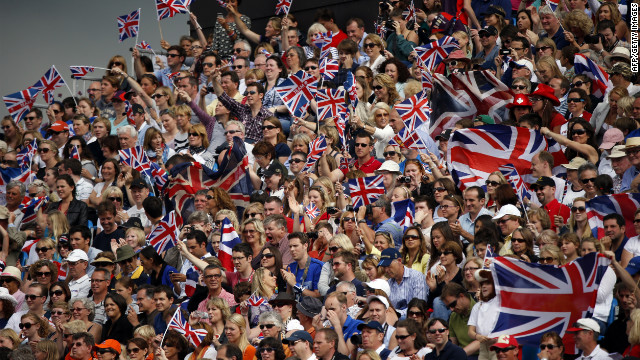 A sea of Team GB's union flags greet competitors at a London Olympic equestrian event.