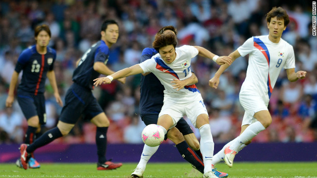 South Korean midfielder Park Jongwoo fights for the ball during the bronze medal football match the London Olympics, August 10, 2012. The IOC withheld Park's medal after he held a banner asserting South Korea's ownership of the contested islands during post-match celebrations.