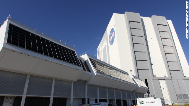 The space center's Vehicle Assembly Building, right, towers over the Launch Control Center, left, at Kennedy Space Center.