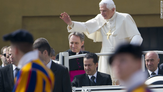 Pope Benedict XVI waves as he stands in his